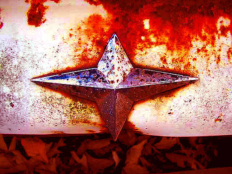 Richard Erickson - old car city hood ornament 2