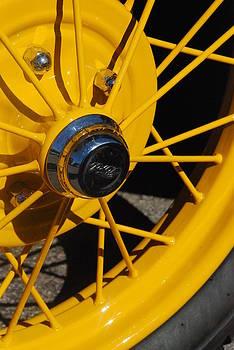 Old Car Wheel by T C Brown