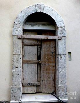 Old door in Italian village by Adriana Joyce
