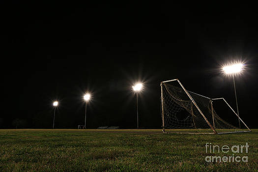 Old Grunge Soccer Goal on a Lit Field at Night by David Lee
