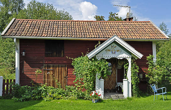 Old red wooden hut by Conny Sjostrom