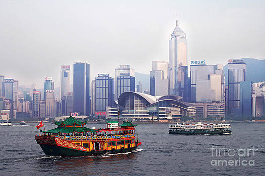 Old traditional chinese junk in front of Hong Kong Skyline by Lars Ruecker