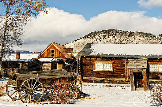 Old Wagon and Ghost Town Buildings by Sue Smith