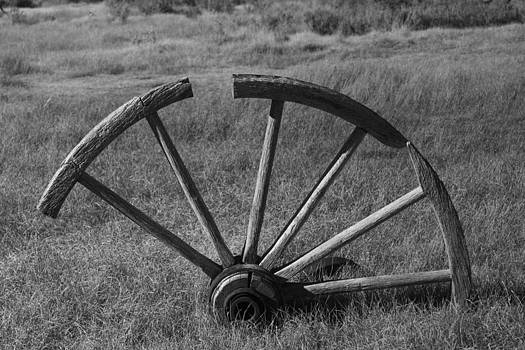 Old vintage Wagon Wheel In Bodie by Lisza Anne McKee