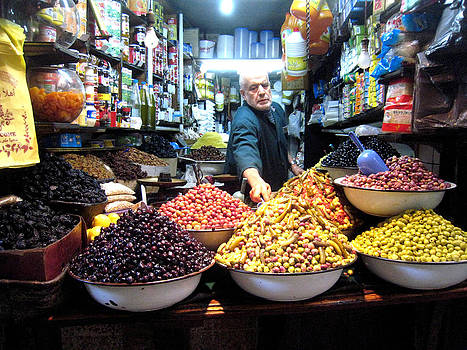 Olive seller in Fez Morocco by Rene Roth