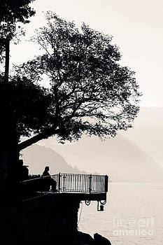 Peter Noyce - one old man sitting in shade of tree overlooking lake como