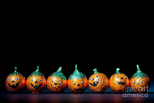 Simon Bratt Photography LRPS - Orange pumpkin wrapped chocolatesin a row