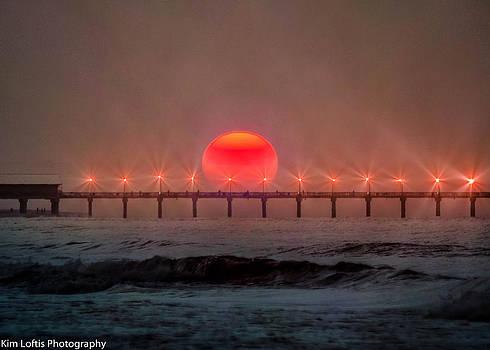 over the Pier  by Kim Loftis