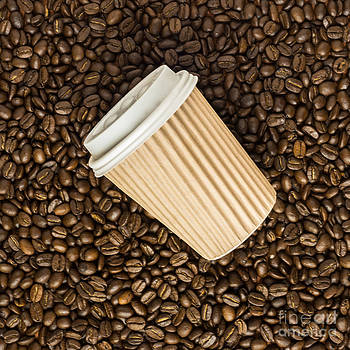 Overhead View Of Takeaway Coffee Cup On Beans by Gillian Vann