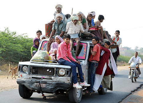 Overloaded Public Transport by Devendra Dube