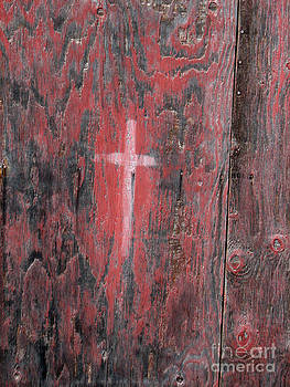 Painted cross on old door by Marie-Pierre Sabga