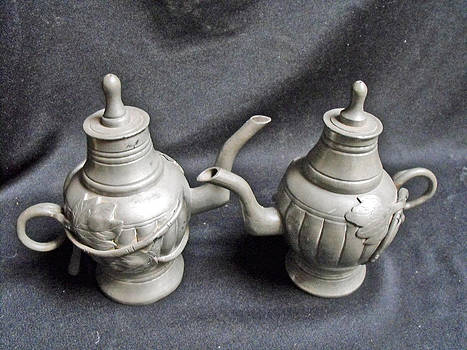Pair of decorated pewter teapots by Anonymous