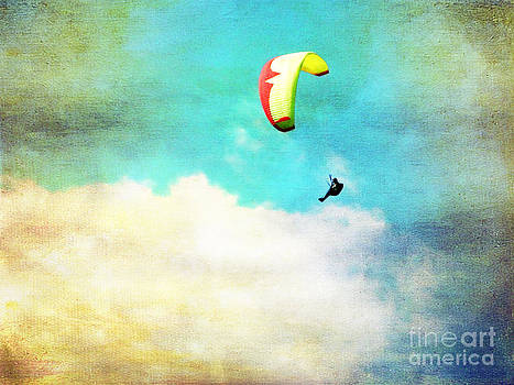 Cindy Singleton - Paraglider Flying Above the Clouds