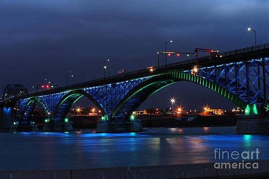 Peace Bridge with green and blue lights by Kim French