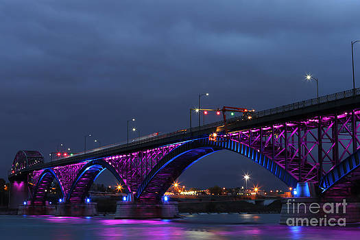 Peace Bridge with purple and blue lights by Kim French