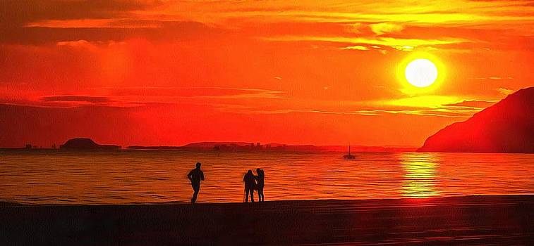 People on the shore at sunset in Spain by Mick Flynn