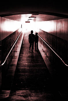 People walking in the tunnel by Kim M Smith