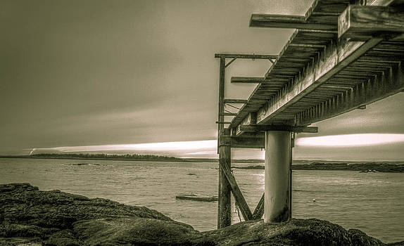 Pier at low tide by Jahred Allen