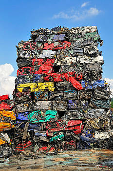 Pile of scrap cars on a wrecking yard by Matthias Hauser