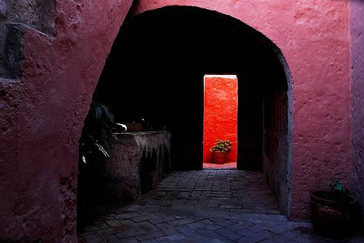 Pink Archway leading to a Vibrant Red Wall by Alessandro Pinto