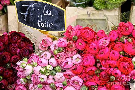 Pink bouquets at a Paris market by Julia Willard