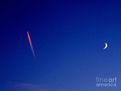 Pink Con Trail and Moon by Donnie Freeman