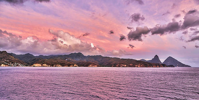Pink sunset cast on the Pitons in St. Lucia by Craig Bowman