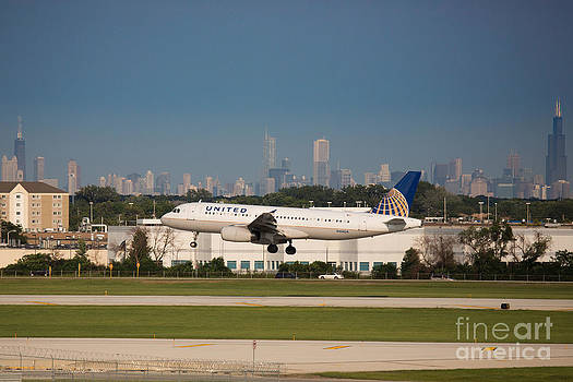 Plane Landing in Chicago by Jason Feldman