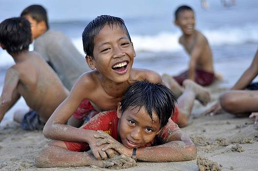 Playing on the beach by Achmad Bachtiar
