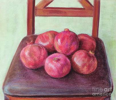 Pomegranates on a chair by Ziba Bastani