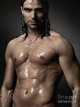 Portrait of man with wet bare torso standing under shower by Oleksiy Maksymenko