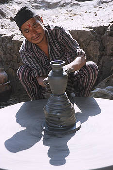Potter at work in Bhaktapur by Richard Berry