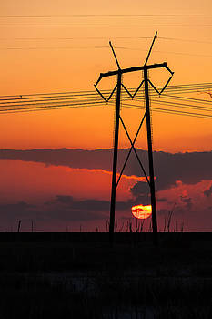 Power Tower With Setting Sun by Ed Gleichman