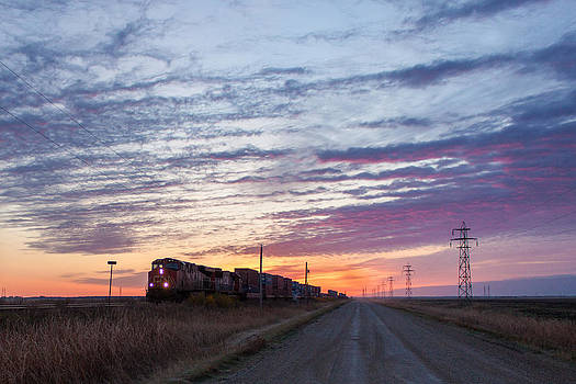 Prairie Sunrise With Train by Steve Boyko