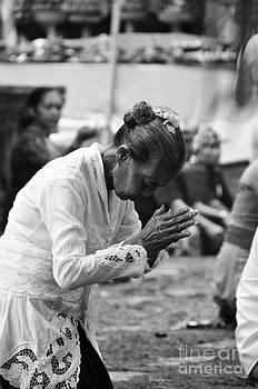 Praying before the war by Wayan Suantara