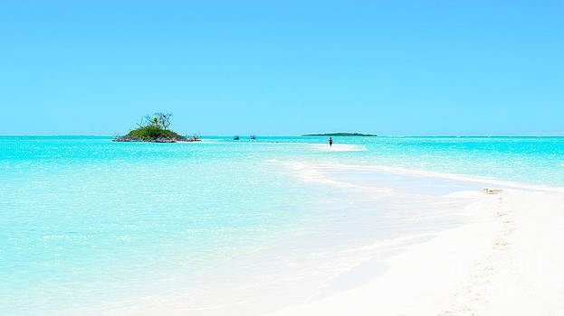 Pristine tropics - an sand bar leading to a small island in the Pacific by David Hill