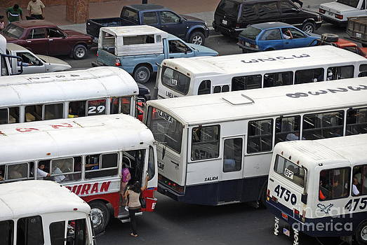 Public buses in traffic jam by Sami Sarkis