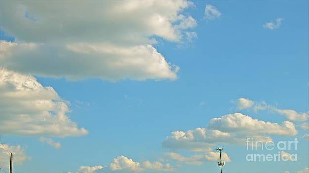 Puffy Clouds by Jason Layden