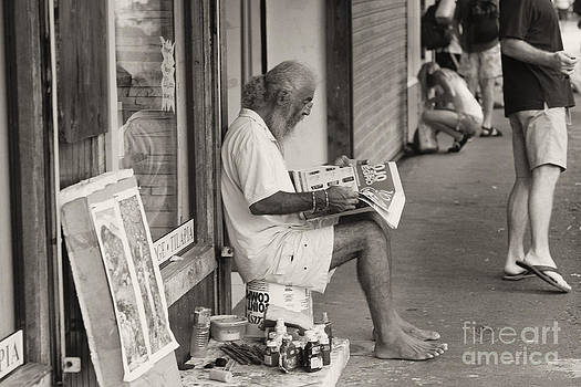 Quepos street artist by Russell Christie