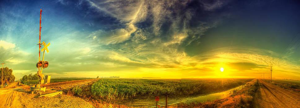 Railroad crossing sunrise by  Caleb McGinn