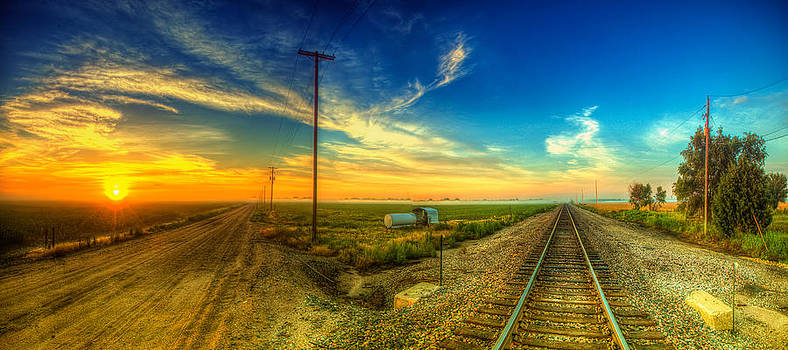 Railroad sunrise panorama by  Caleb McGinn
