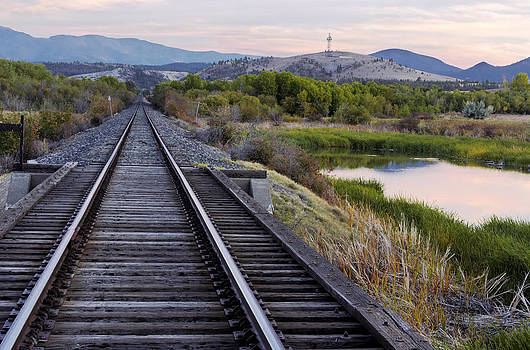 Railroad tracks leading to the mountains by Dana Moyer
