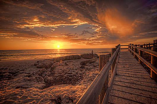 Rain through a sunset by Boyd Nesbitt