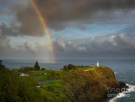 Rainbow over Kilauea lighthouse on Kauai by IPics Photography