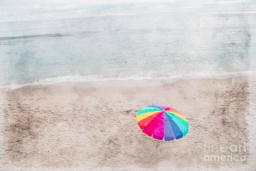 Rainbow Umbrella on Beach by Linda Matlow