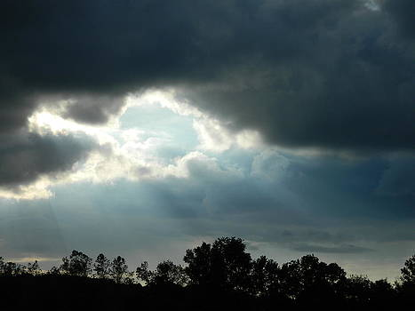 Rays through the clouds by Linda Brown