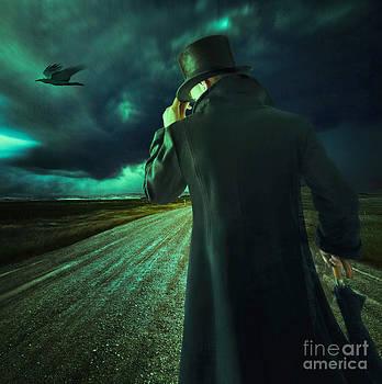 Sandra Cunningham - Rear view of man walking on dirt road
