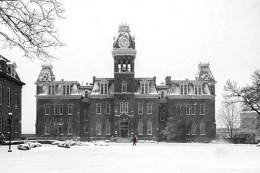 Dan Friend - Red backpack in snow storm Woodburn Hall
