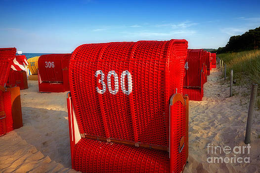 Nick  Biemans - Red beach chairs in the early evening light