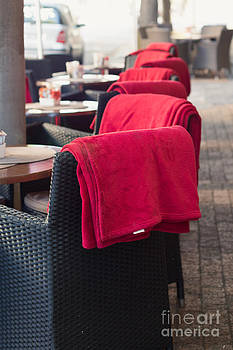 Red Blankets On Cafe Chair by Gillian Vann